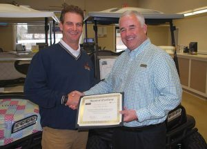 Ocean Lakes Golf Car Manager accepts Club Car Black and Gold Elite award